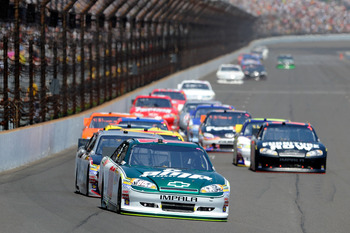 INDIANAPOLIS, IN - JULY 31:  Dale Earnhardt Jr., driver of the #88 Amp Energy/National Guard Chevrolet, leads a pack of cars during the NASCAR Sprint Cup Series Brickyard 400 at Indianapolis Motor Speedway on July 31, 2011 in Indianapolis, Indiana.  (Phot