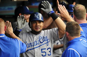 CLEVELAND, OH - JULY 29: Melky Cabrera #53 of the Kansas City Royals celebrates in the dugout after hitting a grand slam during the fourth inning against the Cleveland Indians at Progressive Field on July 29, 2011 in Cleveland, Ohio. (Photo by Jason Mille