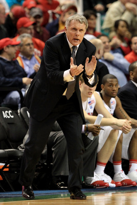 GREENSBORO, NC - MARCH 10:  Head coach Gary Williams of the Maryland Terrapins encourages his team while playing against the North Carolina State Wolfpack during the second half of the game in the first round of the 2011 ACC men's basketball tournament at