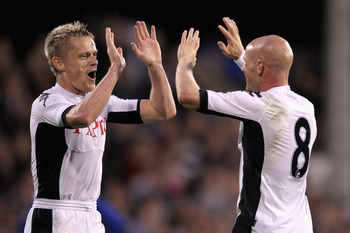 LONDON, ENGLAND - JULY 21:  Damien Duff of Fulham celebrates with teammate Andrew Johnson after their side's third goal scored by Bobby Zamora  during the UEFA Europa League 2nd Qualifying Round 2nd Leg match between Fulham and Crusaders at Craven Cottage
