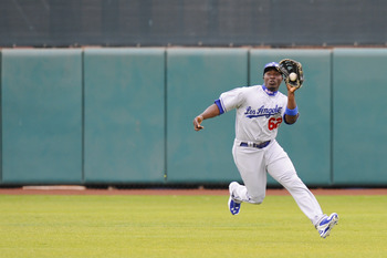 SCOTTSDALE, AZ - FEBRUARY 26: Trayvon Robinson #62 of the Los Angeles Dodgers makes a running catch in the outfield during a spring training game against the San Francisco Giants at Scottsdale Stadium on February 26, 2011 in Scottsdale, Arizona. (Photo by