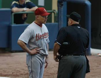 MILWAUKEE, WI - JULY 31: Brad Mills #2 of the Houston Astros talks over a strike call with umpire Eric Cooper against the Milwaukee Brewers at Miller Park on July 31, 2011 in Milwaukee, Wisconsin. (Photo by Scott Boehm/Getty Images)