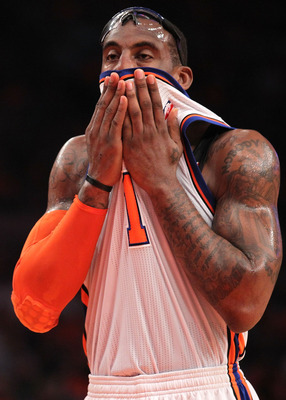 NEW YORK, NY - APRIL 24:  Amar'e Stoudemire #1 of the New York Knicks wipes his face with his jersey in the first quarter against the Boston Celtics in Game Four of the Eastern Conference Quarterfinals during the 2011 NBA Playoffs on April 24, 2011 at Mad