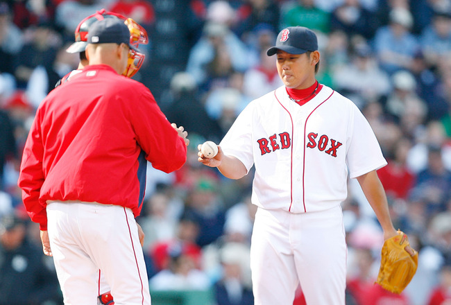 BOSTON - APRIL 9: Manager Terry Francona removes Daisuke Matsuzaka #18 of the Boston Red Sox against the Tampa Bay Rays at Fenway Park, April 9, 2009, in Boston, Massachusetts. (Photo by Jim Rogash/Getty Images)