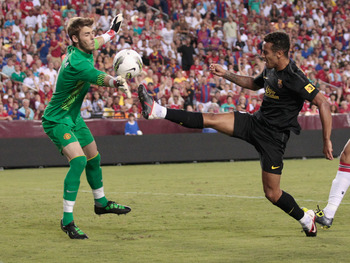 LANDOVER, MD - JULY 30: Goalie David De gea #1 of Manchester United deflects a shot by Thiago Alcantara #4 of Barcelona during the second half of a friendly match at FedExField on July 30, 2011 in Landover, Maryland. Manchester United won 2-1.  (Photo by