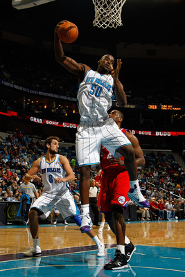 NEW ORLEANS, LA - JANUARY 03:  Emeka Okafor #50 of the New Orleans Hornets rebounds the ball in the second half against the Philadelphia 76ers at New Orleans Arena on January 3, 2011 in New Orleans, Louisiana. NOTE TO USER: User expressly acknowledges and