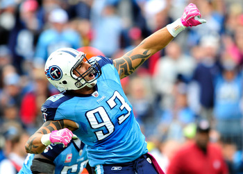 NASHVILLE, TN - OCTOBER 03:  Jason Babin #93 of the Tennessee Titans celebrates after sacking quarterback Kyle Orton #8 of the Denver Broncos during the first half at LP Field on October 3, 2010 in Nashville, Tennessee.  (Photo by Grant Halverson/Getty Im