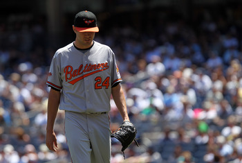 NEW YORK, NY - JULY 30:  Chris Tillman #24 of the Baltimore Orioles walks to the dugout against the New York Yankees  during game one of their double header on July 30, 2011 at Yankee Stadium in the Bronx borough of New York City.  (Photo by Nick Laham/Ge