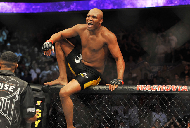 PHILADELPHIA - AUGUST 08:  Anderson Silva celebrates after defeating Forrest Griffin during their light heavyweight bout at UFC 101: Declaration at the Wachovia Center on August 8, 2009 in Philadelphia, Pennsylvania.  (Photo by Jon Kopaloff/Getty Images)