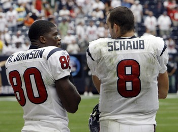 HOUSTON - SEPTEMBER 13:  Wide receiver Andre Johnson #80 and quarterback Matt Schaub of the Houston Texans watch the final moments from the sidelines at Reliant Stadium on September 13, 2009 in Houston, Texas.  (Photo by Bob Levey/Getty Images)