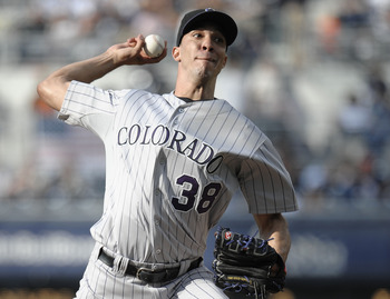 SAN DIEGO, CA - JULY 30: Ubaldo Jimenez #38 of the Colorado Rockies pitches during the first inning of a baseball game against the San Diego Padres at Petco Park on July 30, 2011 in San Diego, California. In a recent announcement Jimenez has been traded t