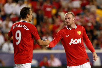 HARRISON, NJ - JULY 27:  Wayne Rooney #10 of the Manchester United congratulates teammate Dimitar Berbatov #9 on his goal against the MLS All-Stars during the second half of the MLS All-Star Game at Red Bull Arena on July 27, 2011 in Harrison, New Jersey.
