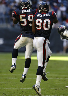 Houston Texans linebacker DeMeco Ryans (59) and defensive end Mario Williams (90) celebrate after a fourth down stop. The Houston Texans defeated the Cleveland Browns 14-6 , Dec. 31, 2006 at Reliant Stadium in Houston, Texas. (Photo by Bob Levey/NFLPhotoL