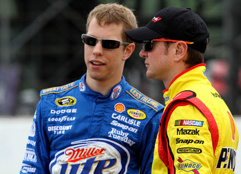 LONG POND, PA - JUNE 11: Brad Kesolowski, driver of the #2 Miller Lite Dodge talks with Kurt Busch, driver of the #22 Shell / Pennzoil Dodge during qualifying for the NASCAR Sprint Cup Series 5-Hour Energy 500 at Pocono Raceway on June 11, 2011 in Long Po