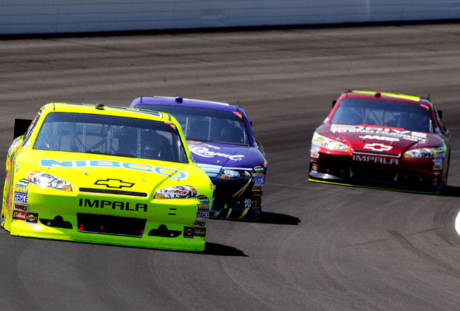 INDIANAPOLIS, IN - JULY 31:  Paul Menard, driver of the #27 NIBCO/Menards Chevrolet, leads Matt Kenseth, driver of the #17 Crown Royal Ford, and Jeff Gordon, driver of the #24 Drive to End Hunger Chevrolet, during the NASCAR Sprint Cup Series Brickyard 40
