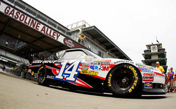 INDIANAPOLIS, IN - JULY 29:  Tony Stewart drives the #14 Mobil 1/Office Depot Chevrolet during practice for the NASCAR Sprint Cup Series Brickyard 400 at Indianapolis Motor Speedway on July 29, 2011 in Indianapolis, Indiana.  (Photo by Mike Ehrmann/Getty