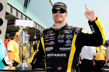 INDIANAPOLIS, IN - JULY 31:  Paul Menard, driver of the #27 NIBCO/Menards Chevrolet, poses with the trophy in Victory Lane after winning the NASCAR Sprint Cup Series Brickyard 400 at Indianapolis Motor Speedway on July 31, 2011 in Indianapolis, Indiana.