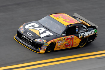 DAYTONA BEACH, FL - JULY 01:  Jeff Burton, driver of the #31 Caterpillar Chevrolet, drives during qualifying for the NASCAR Sprint Cup Series COKE ZERO 400 Powered by Coca-Cola at Daytona International Speedway on July 1, 2011 in Daytona Beach, Florida.