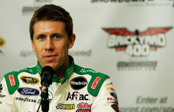 INDIANAPOLIS, IN - JULY 29:  Carl Edwards, driver of the #99 Scotts Ortho Ford, talks to the media prior to practice for the NASCAR Sprint Cup Series Brickyard 400 at Indianapolis Motor Speedway on July 29, 2011 in Indianapolis, Indiana.  (Photo by Mike E
