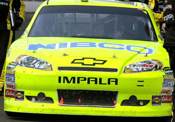 INDIANAPOLIS, IN - JULY 31:  Crew members congratulate Paul Menard, driver of the #27 NIBCO/Menards Chevrolet, after winning the NASCAR Sprint Cup Series Brickyard 400 at Indianapolis Motor Speedway on July 31, 2011 in Indianapolis, Indiana.  (Photo by Je