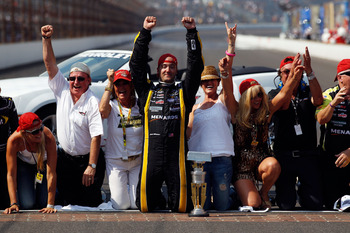 INDIANAPOLIS, IN - JULY 31:  Paul Menard, driver of the #27 NIBCO/Menards Chevrolet, celebrates on the bricks after winning the NASCAR Sprint Cup Series Brickyard 400 at Indianapolis Motor Speedway on July 31, 2011 in Indianapolis, Indiana.  (Photo by Chr