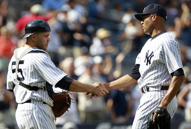 NEW YORK, NY - JULY 31:  Mariano Rivera #42 (R) of the New York Yankees  shakes the hand of catcher Russell Martin after closing the ninth inning against the Baltimore Orioles on July 31, 2011 at Yankee Stadium in the Bronx borough of New York City. The Y