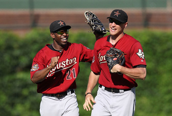 CHICAGO - JULY 21: Michael Bourn #21 and Hunter Pence #9 of the Houston Astros celebrate a win over the Chicago Cubs at Wrigley Field on July 21, 2010 in Chicago, Illinois. The Astros defeated the Cubs 4-3 in 12 innings. (Photo by Jonathan Daniel/Getty Im