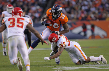 DENVER - NOVEMBER 14:  Wide receiver Demaryius Thomas #88 of the Denver Broncos makes a pass reception as Brandon Carr #39 of the Kansas City Chiefs makes the tackle at INVESCO Field at Mile High on November 14, 2010 in Denver, Colorado. The Broncos defea
