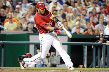 WASHINGTON, DC - JULY 30:  Michael Morse #38 of the Washington Nationals hits a single in the eighth inning against the New York Mets at Nationals Park on July 30, 2011 in Washington, DC. The Nationals won the game 3-0.  (Photo by Greg Fiume/Getty Images)