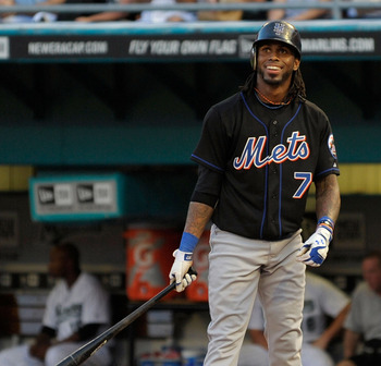 MIAMI GARDENS, FL - JULY 23:  Jose Reyes #7 of the New York Mets smiles at bat after a strike is called during a game against the Florida Marlins at Sun Life Stadium on July 23, 2011 in Miami Gardens, Florida.  (Photo by Sarah Glenn/Getty Images)