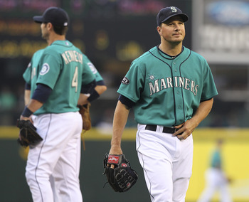 SEATTLE - JULY 29:  Starting pitcher Erik Bedard #45 of the Seattle Mariners heads off the mound after being removed from the game in the second inning by manager Eric Wedge against the Tampa Bay Rays at Safeco Field on July 29, 2011 in Seattle, Washingto