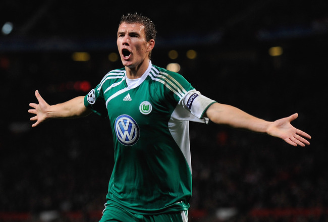 MANCHESTER, ENGLAND - SEPTEMBER 30:  Edin Dzeko of VfL Wolfsburg celebrates scoring the opening goal during the UEFA Champions League Group B match between Manchester United and VfL Wolfsburg at Old Trafford on September 30, 2009 in Manchester, England.