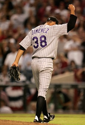 PHOENIX - OCTOBER 12:  Starting pitcher Ubaldo Jimenez #38 of the Colorado Rockies celebrates after getting out of the fifth inning against the Arizona Diamondbacks in Game Two of the National League Championship Series at Chase Field on October 12, 2007
