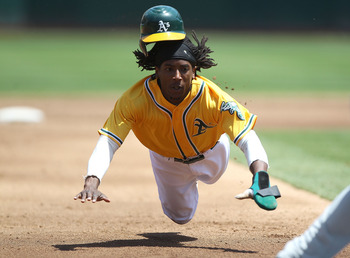 OAKLAND, CA - JULY 31:  Jemile Weeks #19 of the Oakland Athletics steals third base in the third inning against the Minnesota Twins at O.co Coliseum on July 31, 2011 in Oakland, California.  (Photo by Jed Jacobsohn/Getty Images)