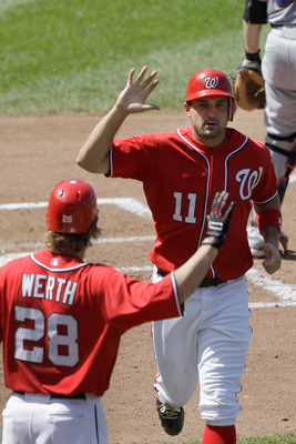 WASHINGTON, DC - JULY 31: Ryan Zimmerman #11 of the Washington Nationals celebrates scoring with teammate Jayson Werth #28 duirng the sixth inning against the New York Mets  at Nationals Park on July 31, 2011 in Washington, DC. The Nationals won 3-2. (Pho