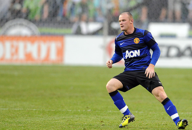 SEATTLE, WA - JULY 20: Wayne Rooney #10 of Manchester United reacts to a corner kick during the second half of the game at CenturyLink Field on July 20, 2011 in Seattle, Washington. (Photo by Steve Dykes/Getty Images)