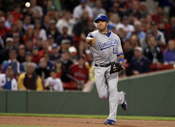 BOSTON, MA - JULY 25:  Mike Aviles #13 of the Kansas City Royals sends the ball to first for the out against the Boston Red Sox on July 25, 2011 at Fenway Park in Boston, Massachusetts.  (Photo by Elsa/Getty Images)