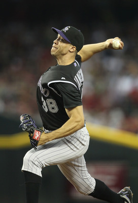 PHOENIX, AZ - JULY 24:  Starting pitcher Ubaldo Jimenez #38 of the Colorado Rockies pitches against the Arizona Diamondbacks during the Major League Baseball game at Chase Field on July 24, 2011 in Phoenix, Arizona.  The Diamondbacks defeated the Rockies