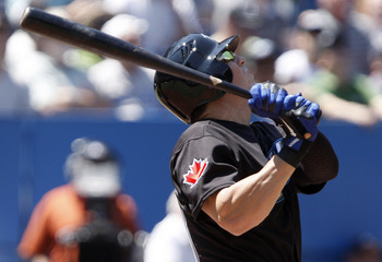 TORONTO, CANADA - JULY 30:  Colby Rasmus #28 of the Toronto Blue Jays flies out during MLB action at the Rogers Centre July 30, 2011 in Toronto, Ontario, Canada. (Photo by Abelimages/Getty Images)