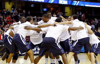 CLEVELAND, OH - MARCH 18: The Villanova Wildcats warm up in a huddle before the game against the George Mason Patriots during the second round of the 2011 NCAA men's basketball tournament at Quicken Loans Arena on March 18, 2011 in Cleveland, Ohio.  (Phot