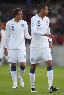 HERNING, DENMARK - JUNE 12: Phil Jones (L) and Chris Smalling (R) of England during the UEFA European Under-21 Championship Group B match between England and Spain at the Herning Stadium on June 12, 2011 in Herning, Denmark.  (Photo by Michael Steele/Gett