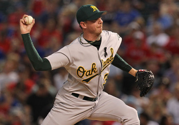 ARLINGTON, TX - JULY 08:  Brad Ziegler #31 of the Oakland Athletics throws against the Texas Rangers at Rangers Ballpark in Arlington on July 8, 2011 in Arlington, Texas.  (Photo by Ronald Martinez/Getty Images)