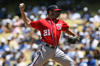 LOS ANGELES, CA - JULY 24:  Jason Marquis #21 of the Washington Nationals pitches against the Los Angeles Dodgers in the first inning of the game at Dodger Stadium on July 24, 2011 in Los Angeles, California.  (Photo by Jeff Golden/Getty Images)