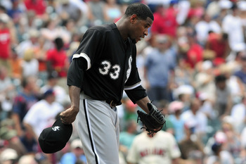 CLEVELAND, OH - JULY 24: Starting pitcher Edwin Jackson #33 of the Chicago White Sox reacts after giving up a run during the sixth inning against the Cleveland Indians at Progressive Field on July 24, 2011 in Cleveland, Ohio. (Photo by Jason Miller/Getty