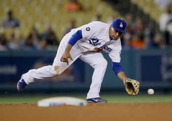 LOS ANGELES, CA - JULY 27:  Shortstop Rafael Furcal #15 of the Los Angeles Dodgers can't make the play on a ball hit by Troy Tulowitzki (not pictured) of the Colorado Rockies in the ninth inning at Dodger Stadium on July 27, 2011 in Los Angeles, Californi
