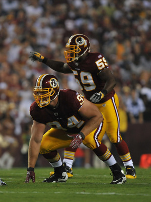 LANDOVER - SEPTEMBER 12:  Adam Carriker #94 of the Washington Redskins defends during the NFL season opener against the Dallas Cowboys at FedExField on September 12, 2010 in Landover, Maryland. The Redskins defeated the Cowboys 13-7. (Photo by Larry Frenc