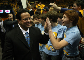 MILWAUKEE - FEBRUARY 15:  Head coach Tom Crean of the Marquette Golden Eagles greets student fans before a game against the Pittsburgh Panthers on February 15, 2008 at the Bradley Center in Milwaukee, Wisconsin. Marquette defeated Pittsburgh 72-54. (Photo