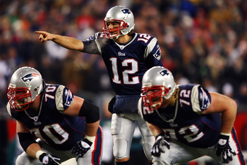 FOXBORO, MA - NOVEMBER 25:  Tom Brady #12 of the New England Patriots calls a play at the line against the Philadelphia Eagles at Gillette Stadium on November 25, 2007 in Foxboro, Massachusetts.  (Photo by Elsa/Getty Images)