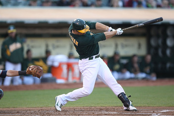 OAKLAND, CA - JULY 29:  Josh Willingham #16 of the Oakland Athletics hits a two run home run against the Minnesota Twins at O.co Coliseum on July 29, 2011 in Oakland, California.  (Photo by Jed Jacobsohn/Getty Images)