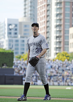 SAN DIEGO, CA - JULY 30: Ubaldo Jimenez #38 of the Colorado Rockies walks off the field after pitching during the first inning of a baseball game against the San Diego Padres at Petco Park on July 30, 2011 in San Diego, California.  (Photo by Denis Poroy/